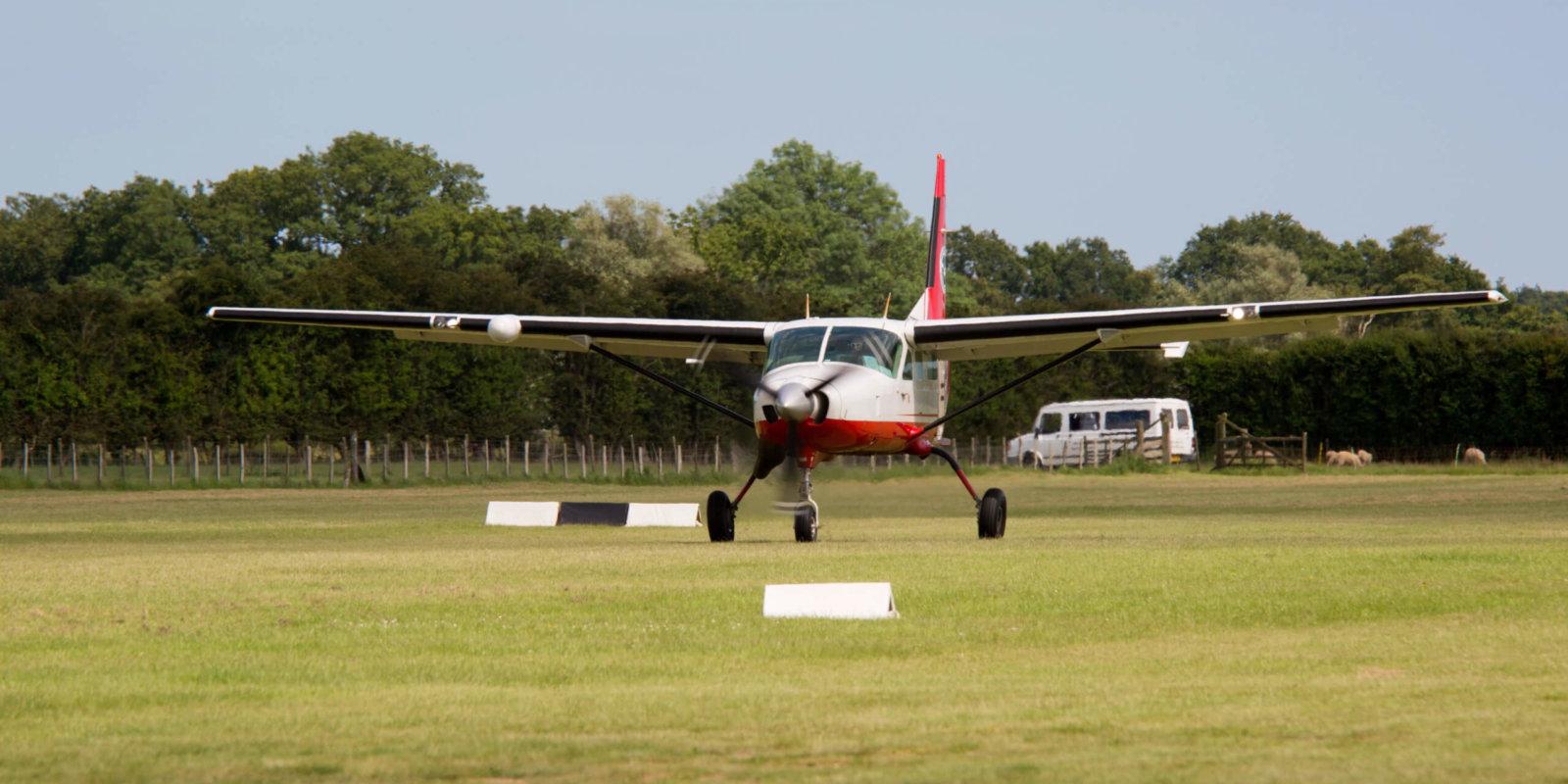 Cessna 208 Caravan 1 G-GOHI Rusol Air Headcorn Parachute Club landing on grass runway at Headcorn Airfield