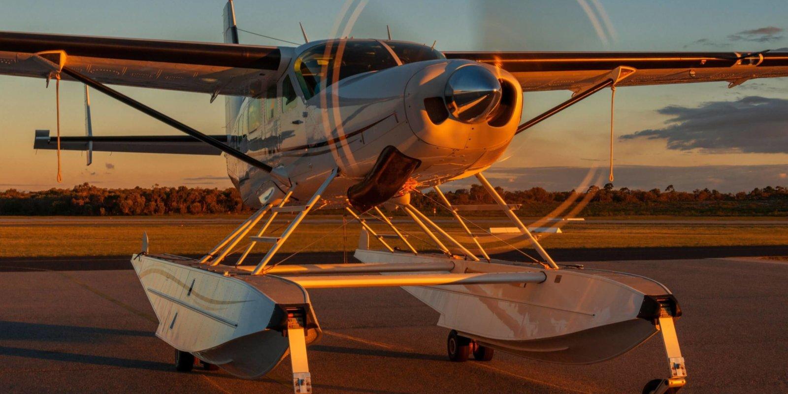 Sunset illuminating a Cessna 208 Grand Caravan float plane.
